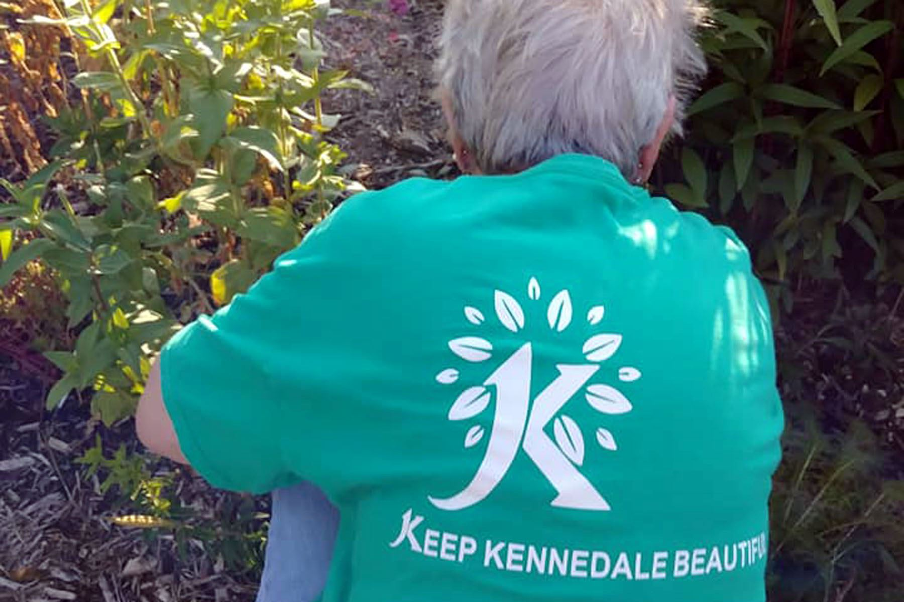 "Person Wearing ""Keep Kennedale Beautiful"" Shirt"